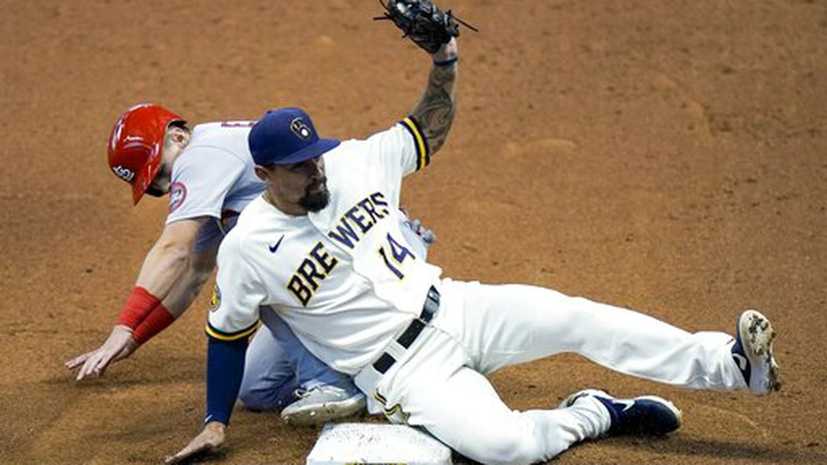 Milwaukee Brewers' Jace Peterson tags out St. Louis Cardinals' Tommy Edman as he is caught stealing third during the fifth inning of the first game of a baseball doubleheader Wednesday, Sept. 16, 2020, in Milwaukee. (AP Photo/Morry Gash)