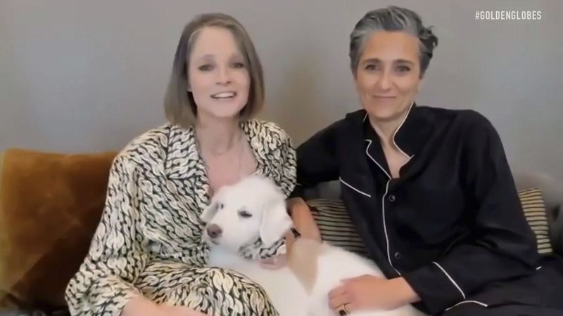 In this video grab issued Sunday, Feb. 28, 2021, by NBC, Jodie Foster, left, holding her dog...