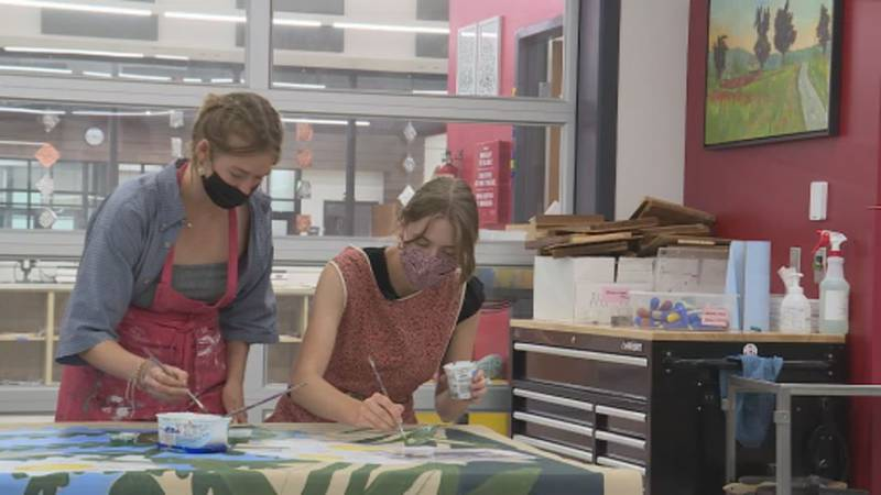 Students paint a mural for mental health awareness at Mount Horeb High School.
