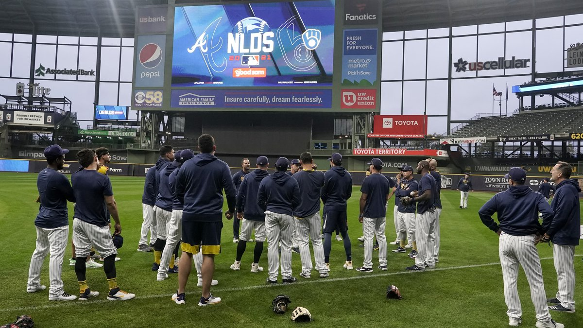 Milwaukee Brewers manager Craig Counsell talks to his players at a practice for the Game 1 of...