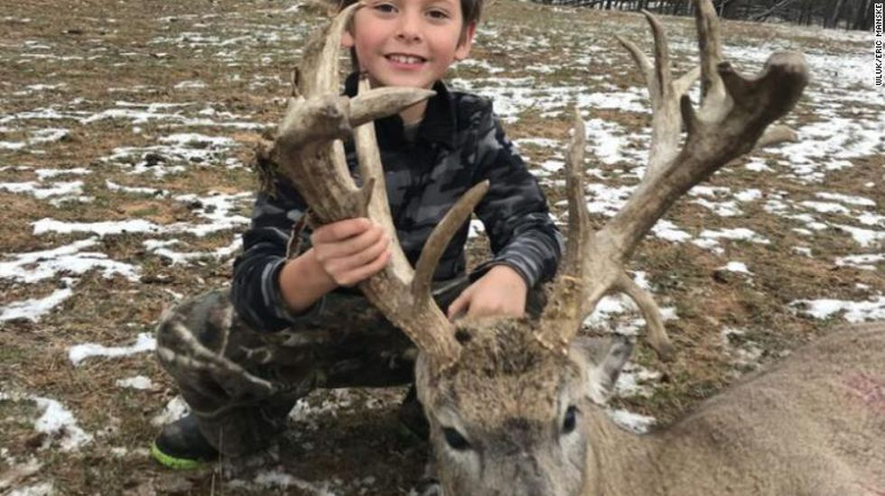 Jericho Manske, 7, shows off the 21-point buck he shot in Oconto Co.