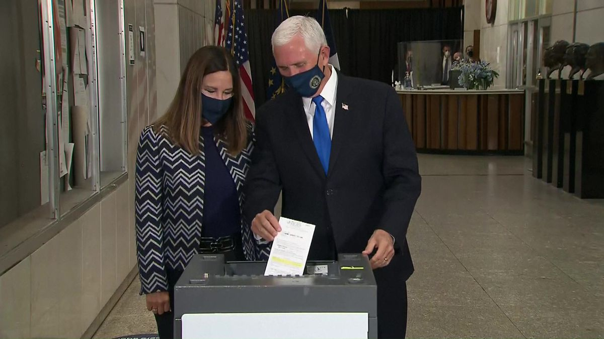 Vice President Mike Pence and his wife, Karen, cast absentee ballots about 8:15 a.m. Friday in...