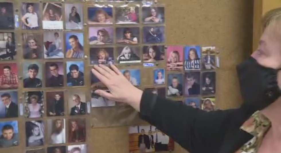 School counselor Colleen Wells shows off the graduation photo wall in her office.