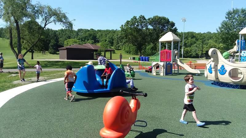 Children enjoy the accessible playground at Madison's Elver Park.