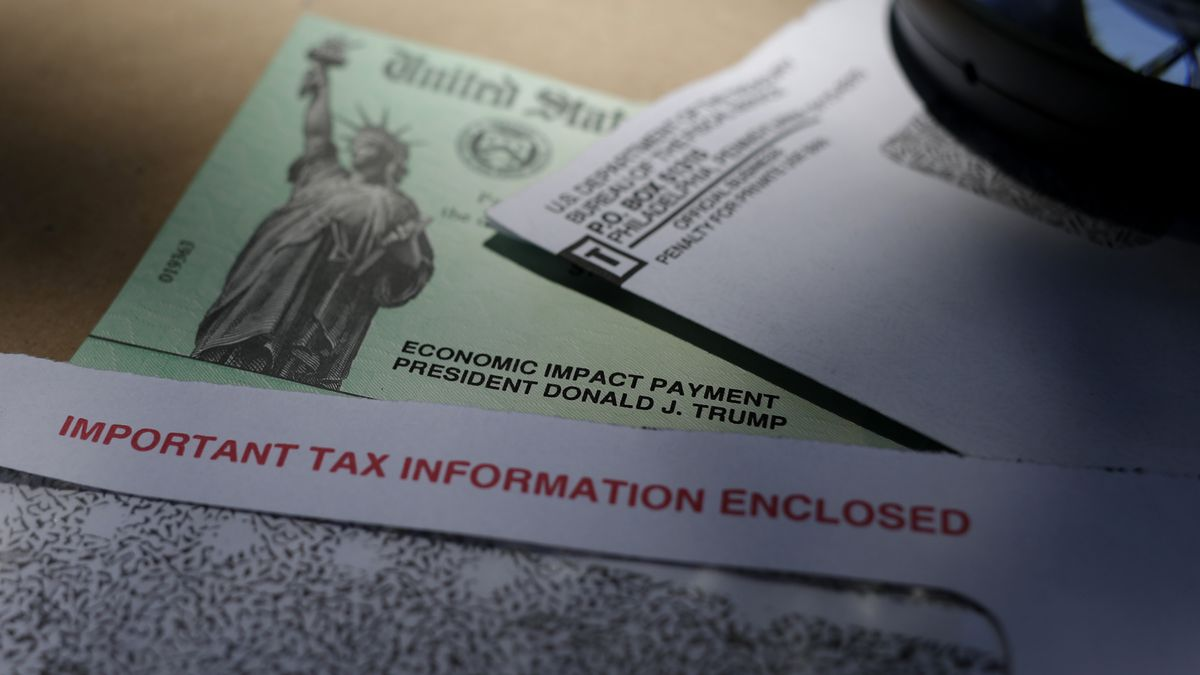 FILE - In this April 23, 2020, file photo, President Donald Trump's name is seen on a stimulus...