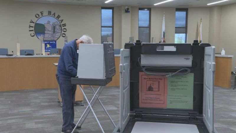 A man casts his ballot via in-person absentee voting in Baraboo.