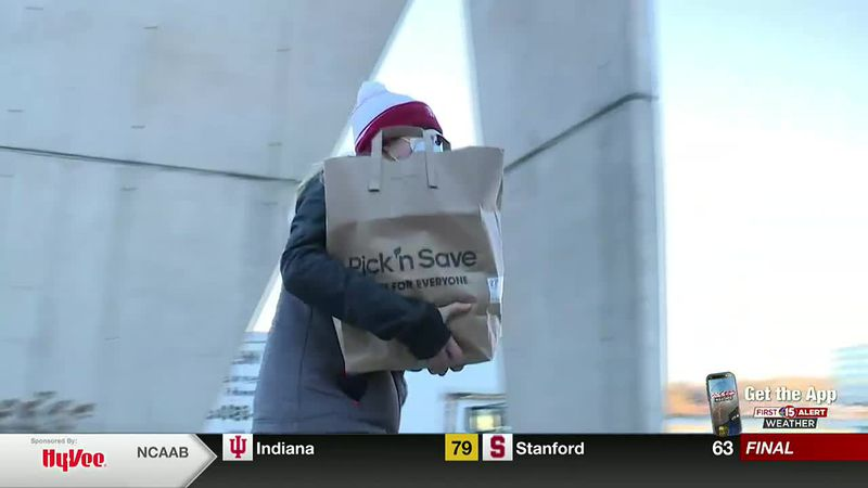 Wisconsin Badgers give back at Share Your Holidays Celebration Drive Thru Food Drive