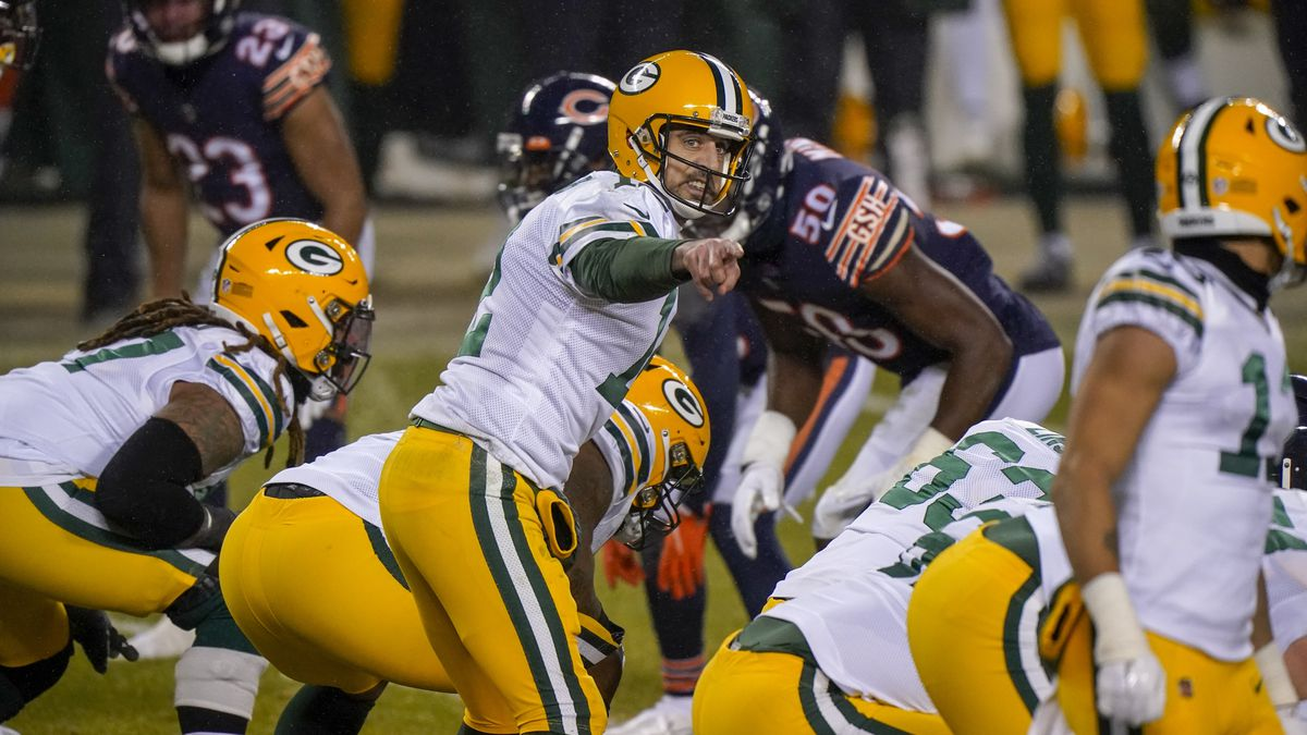 Green Bay Packers' Aaron Rodgers calls a play during the second half of an NFL football game...