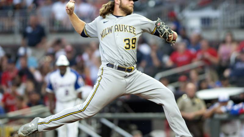 Milwaukee Brewers starting pitcher Corbin Burnes throws during the first inning of a baseball...