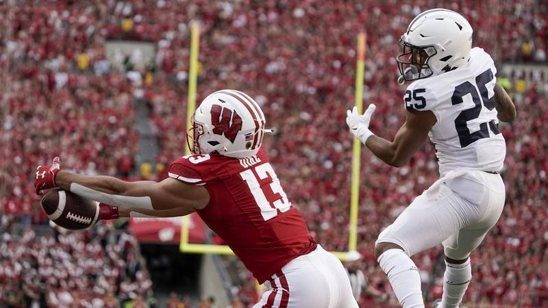 Wisconsin's Chimere Dike drops a pass in the end zone in front of Penn State's Daequan Hardy...