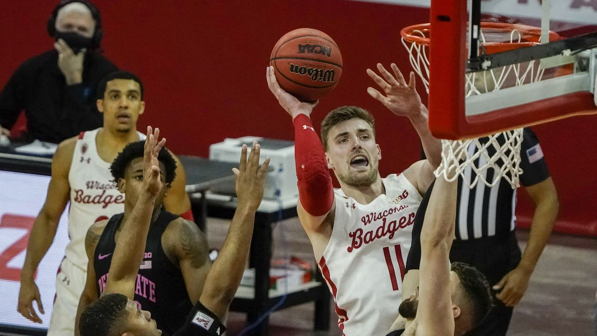 Wisconsin's Micah Potter shoots during the second half of an NCAA college basketball game...