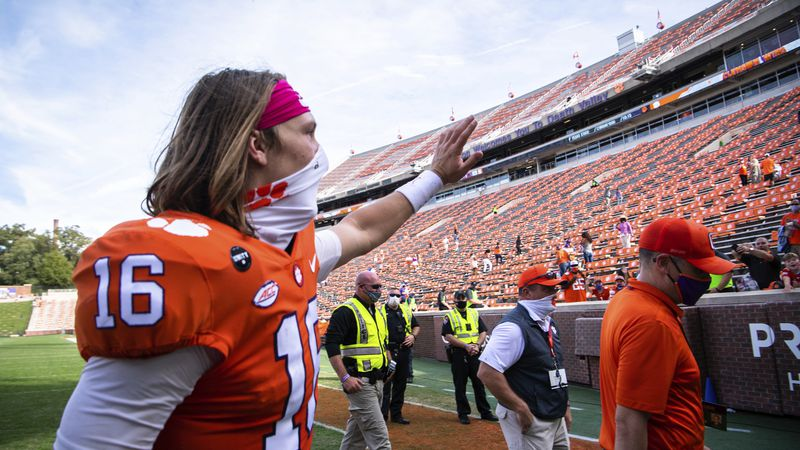 Clemson quarterback Trevor Lawrence (16) waves to fans after an NCAA college football game...