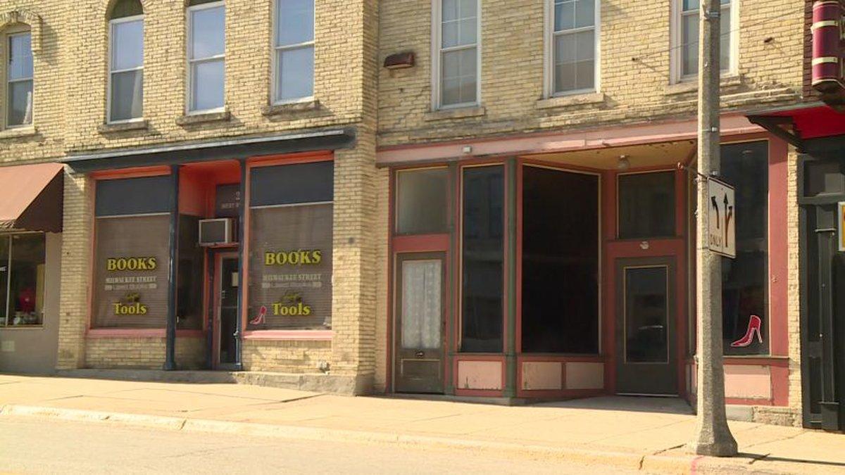 Dark storefronts along Milwaukee Street in Janesville.