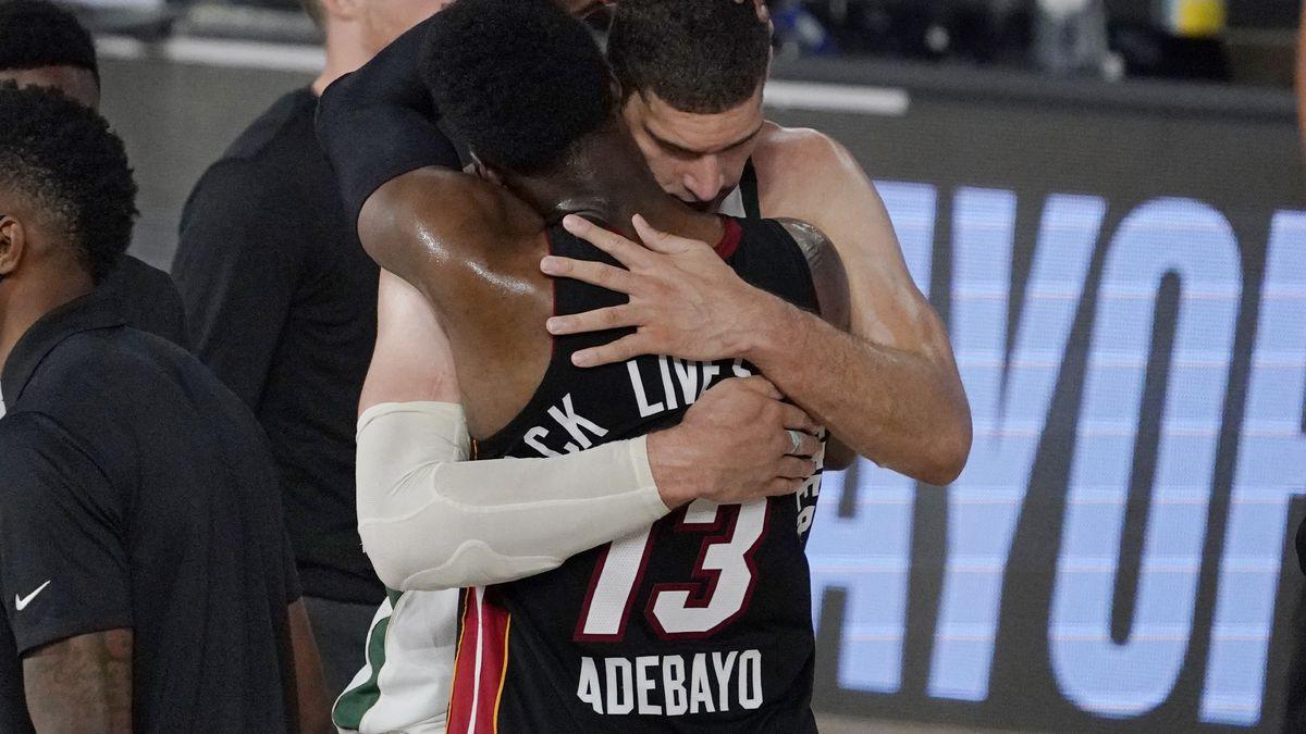 Milwaukee Bucks' Brook Lopez, rear, and Miami Heat's Bam Adebayo (13) embrace following their...