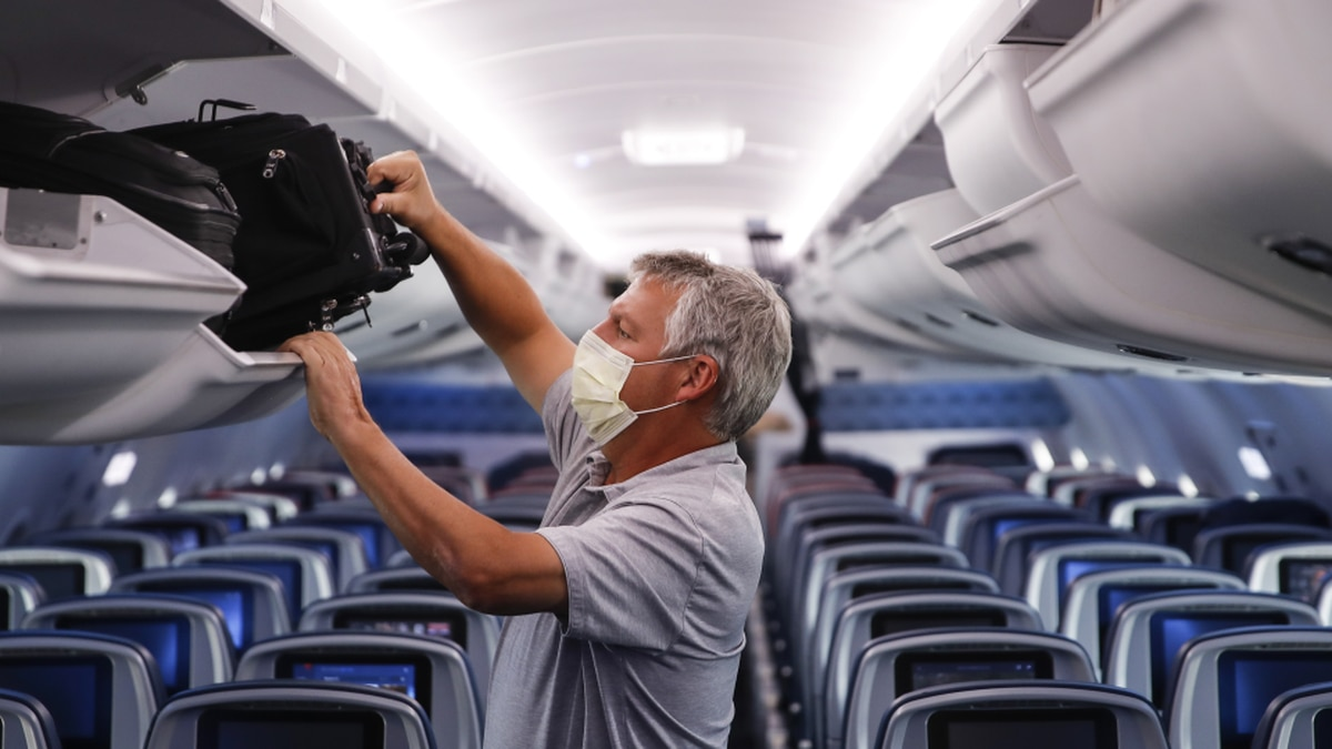 FILE - In this May 28, 2020, file photo, a passenger wears personal protective equipment on a...