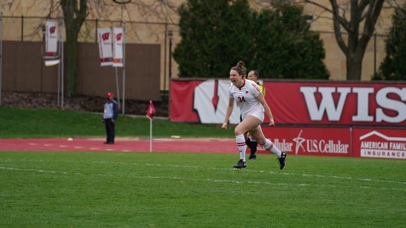 Claire Odmark celebrates her game-winning penalty kick to advance Wisconsin to the Big Ten...