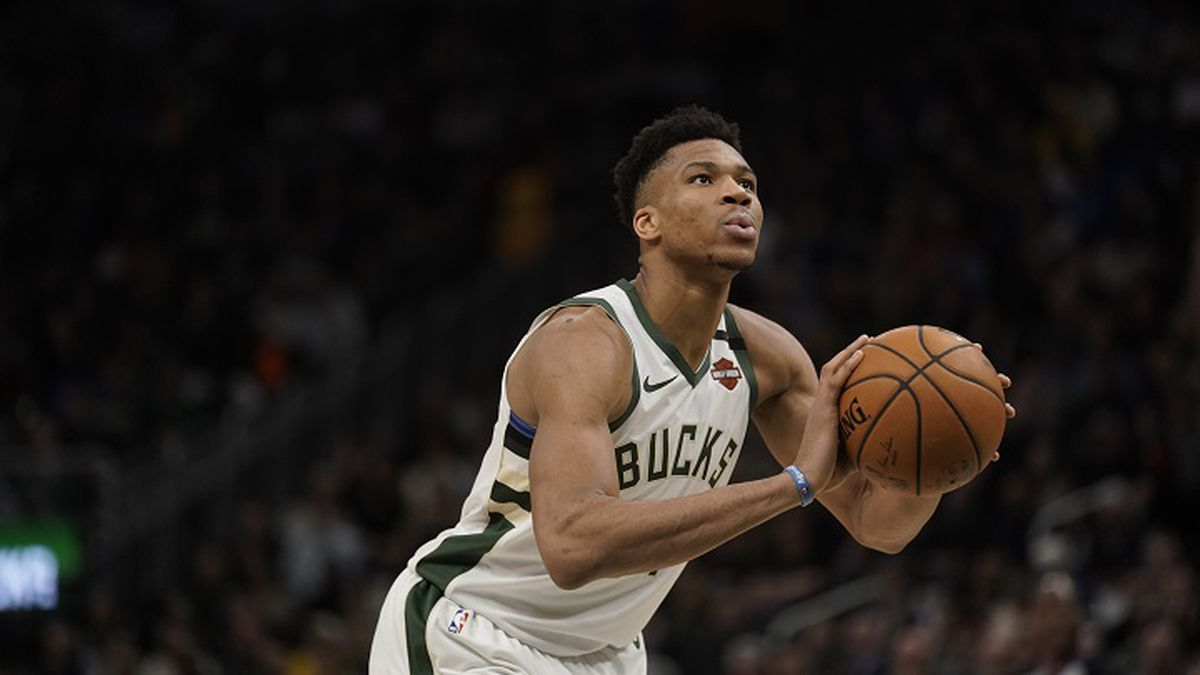 Milwaukee Bucks' Giannis Antetokounmpo shoots during the second half of an NBA basketball game against the Indiana Pacers Wednesday, March 4, 2020, in Milwaukee. The Bucks won 119-100. (AP Photo/Morry Gash)