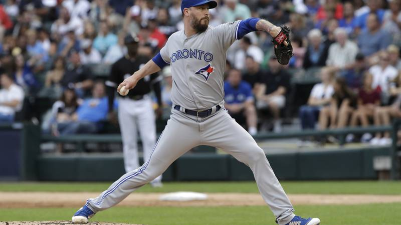 FILE - Toronto Blue Jays starting pitcher John Axford throws against the Chicago White Sox...