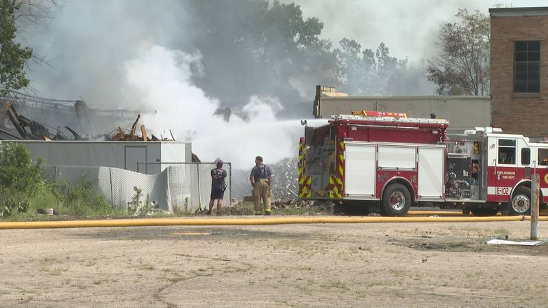 Fort Atkinson firefighters continue to put out flames after a warehouse burned to the ground...