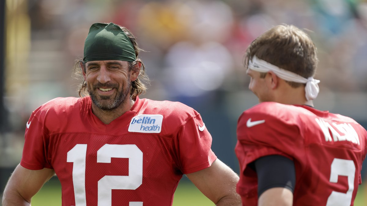 Green Bay Packers quarterback Aaron Rodgers (12) and New York Jets quarterback Zach Wilson (2)...