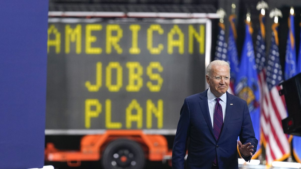 President Joe Biden arrives to speak about infrastructure spending at the La Crosse Municipal...