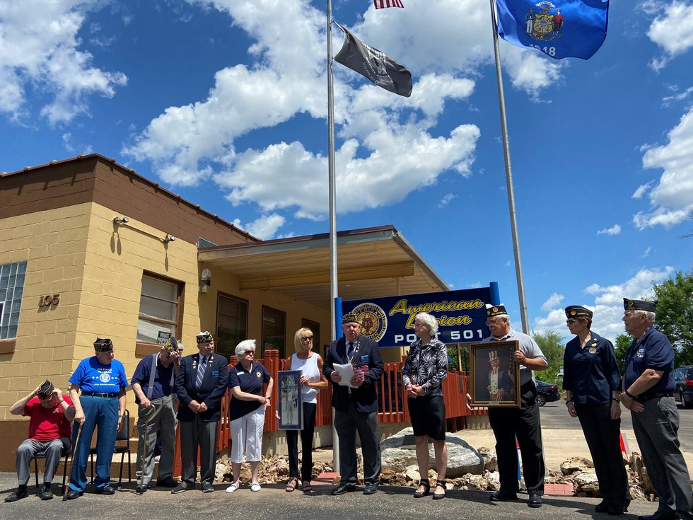 Post members and family members gather on Flag Day to re-dedicate the memorial to Madison's...
