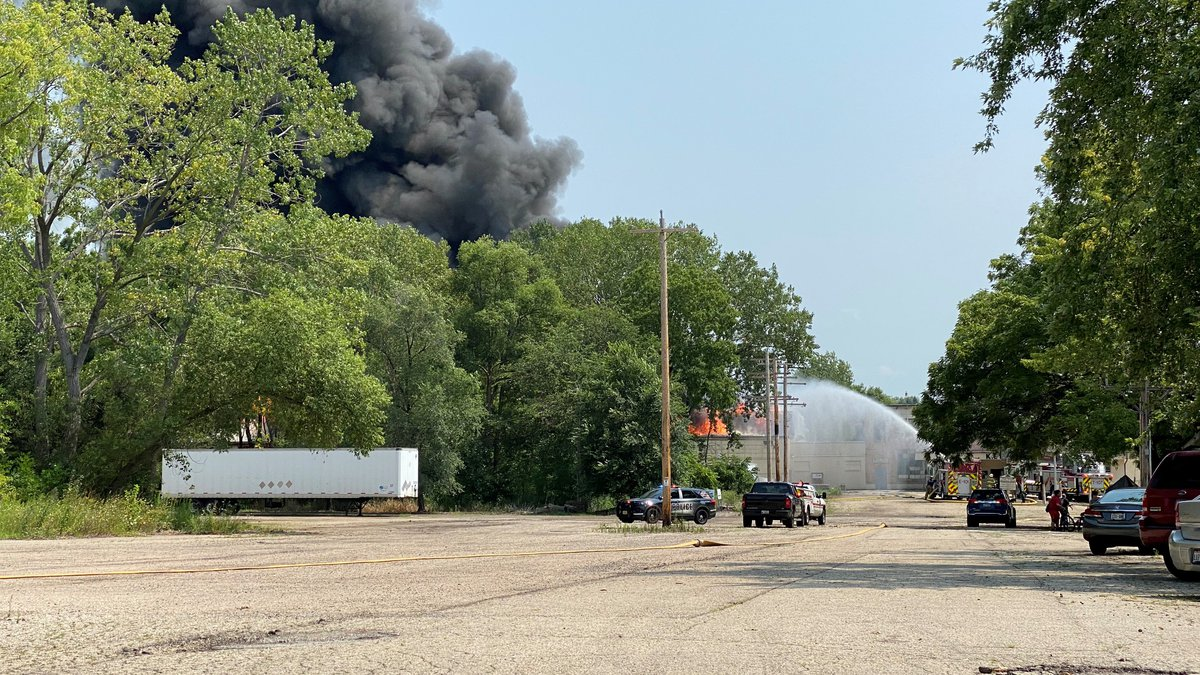 Firefighters respond to a large fire in Fort Atkinson, Wisconsin, on August 10, 2021.