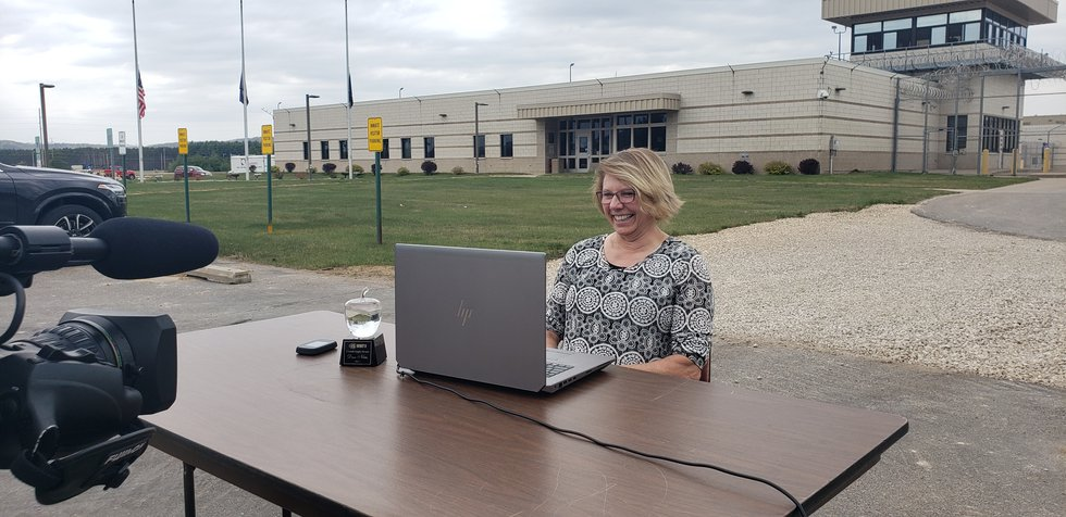 Mrs. Diane Noble talks with the inmate who nominated her for a Crystal Apple Award on zoom, as...