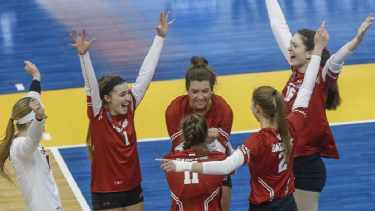 The Wisconsin team celebrates after defeating Baylor in a semifinal of the NCAA Division I...