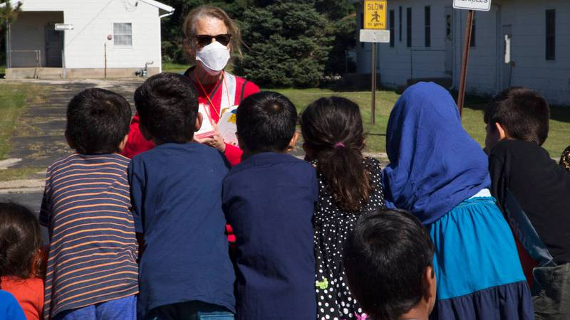 Kathleen Hughes, standing center, an American Red Cross volunteer working with Task Force...