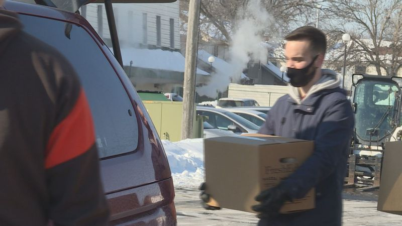 Volunteers from City on a Hill distribute more than a thousand boxes of food on Saturday.