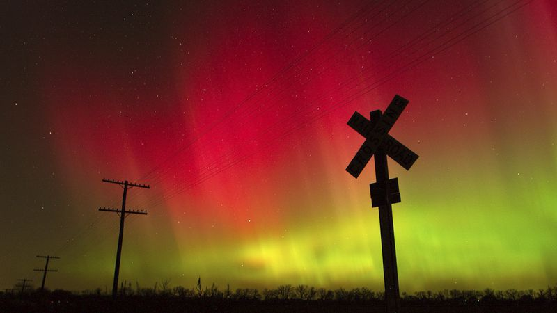 In this Nov. 8, 2004, file photo, the aurora borealis lights up the sky northwest of Lawrence,...