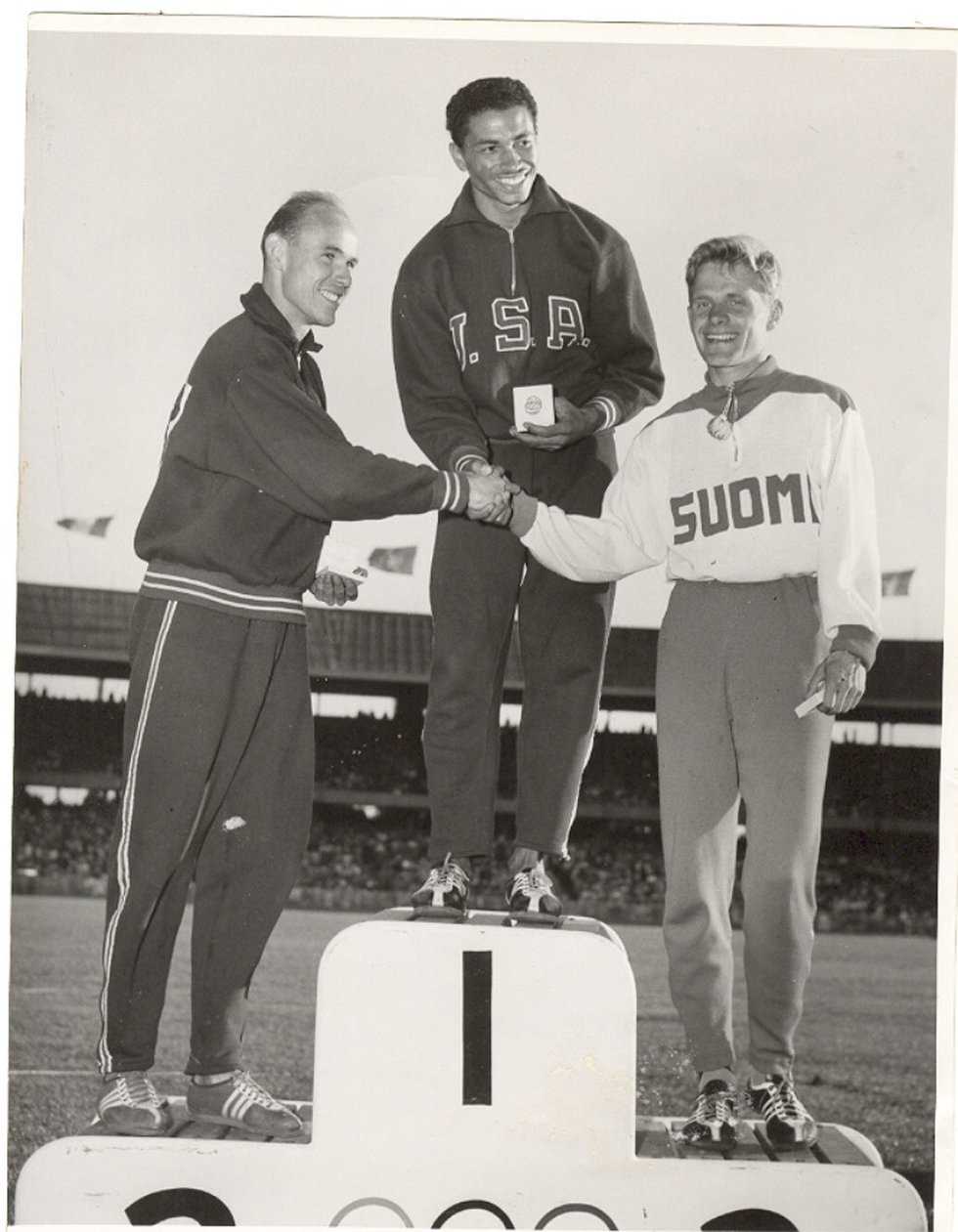 Bennett poses on the Olympic podium with the two other medal winners from the long jump event...
