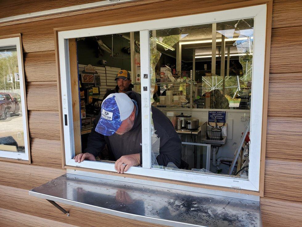 Repairs on the broken window were underway Thursday morning