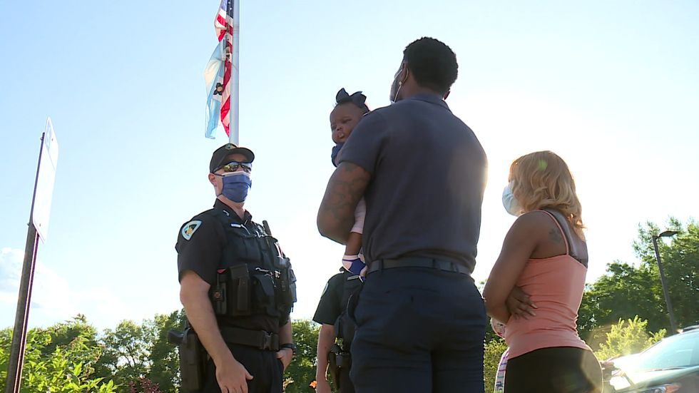 Officer reunites with baby he saved from choking