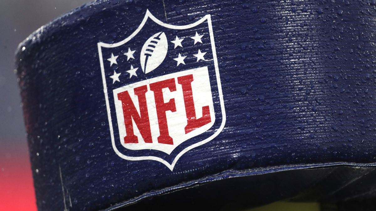 FILE - In this Dec. 1, 2019, file photo, rain drops are seen on the NFL logo on padding of a...