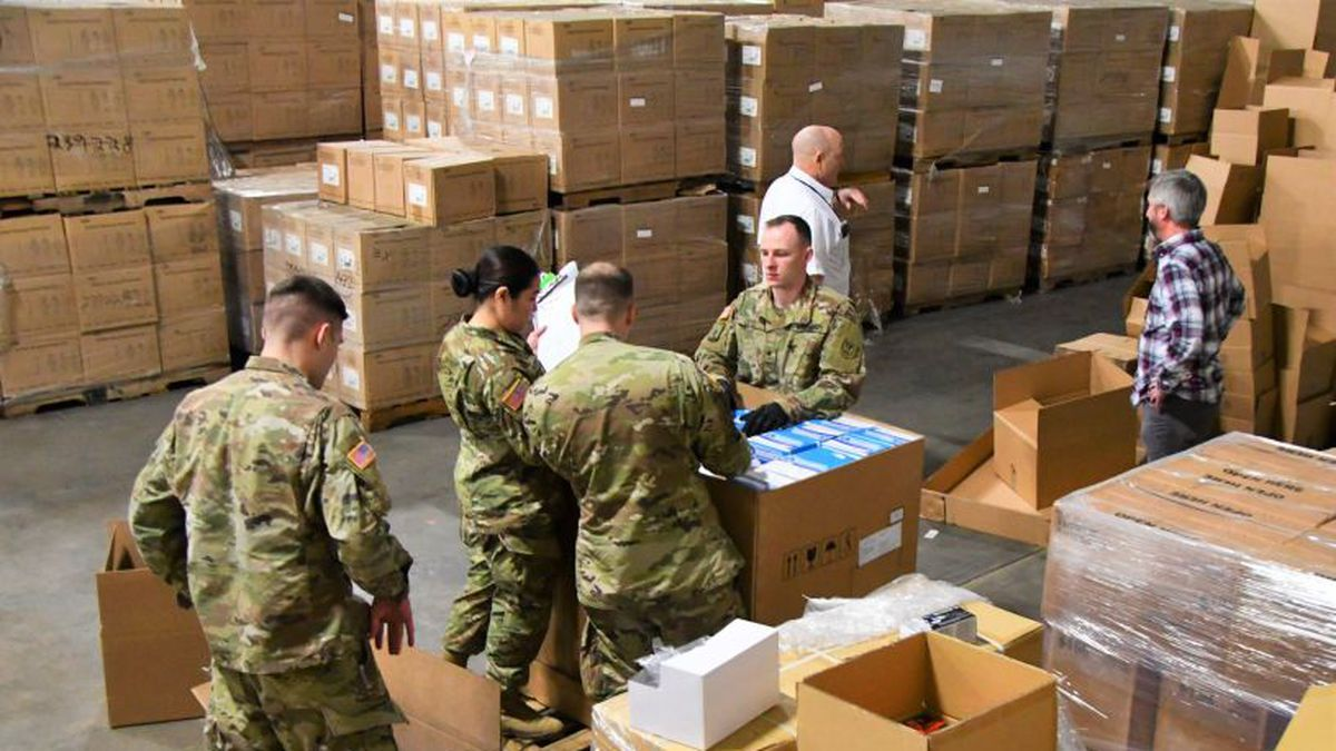Wisconsin health workers unloading medical supplies from the Strategic National Stockpile...