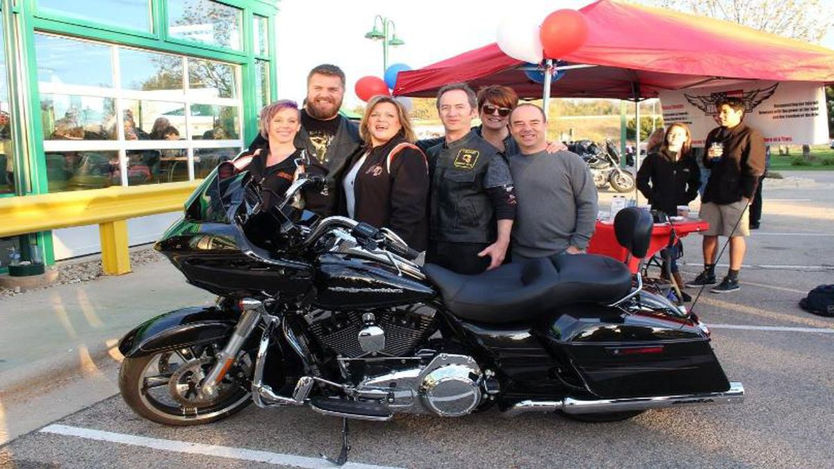 (L to R) Amy & Scott Kruchten; Hogs for Heroes Founders Audra, Kevin, Michelle, & Craig Thompson