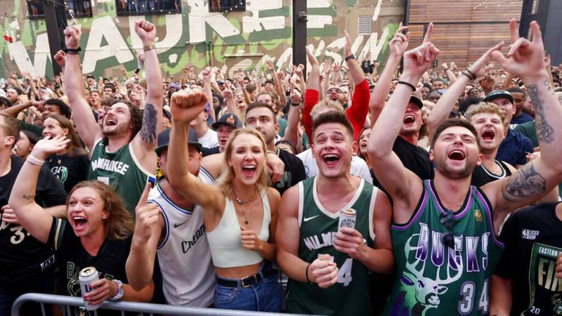 Fans cheer as they watch Game 6 of the NBA basketball finals game between the Milwaukee Bucks...