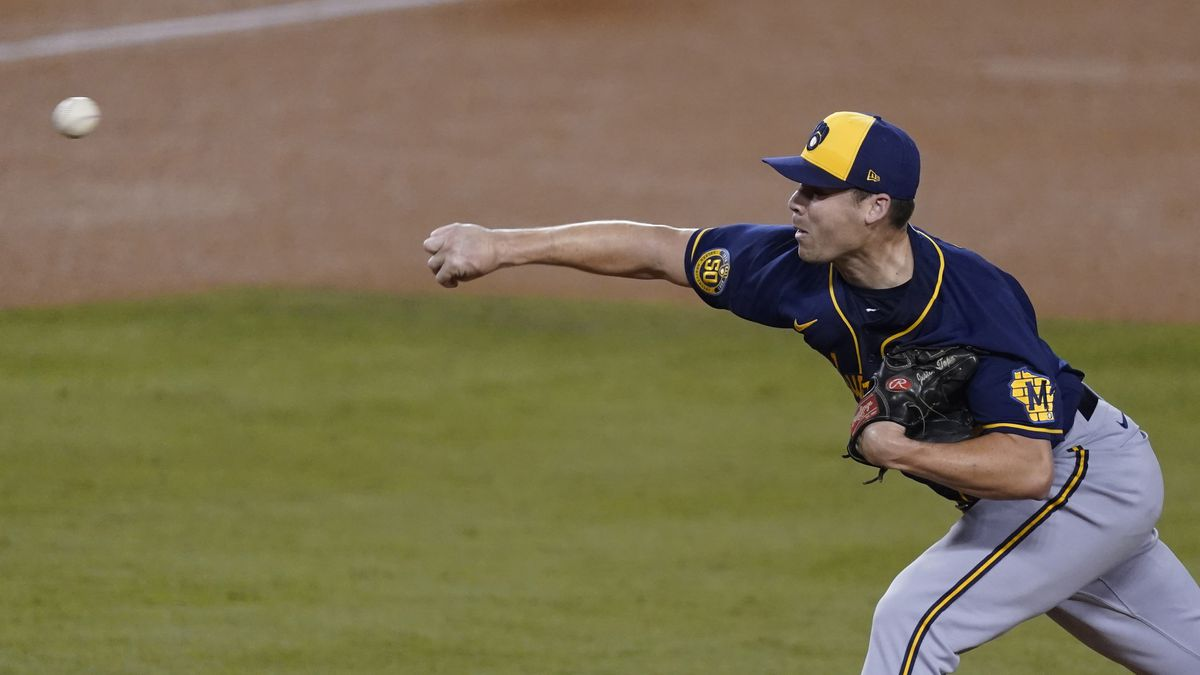FILE - Milwaukee Brewers relief pitcher Justin Topa throws to the Los Angeles Dodgers during...