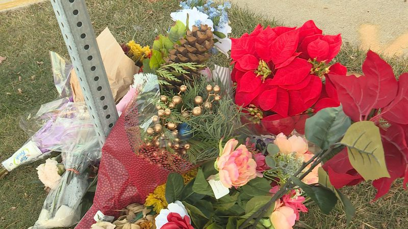 Flowers mark the scene of a fatal crash in Sun Prairie on Nov. 23.
