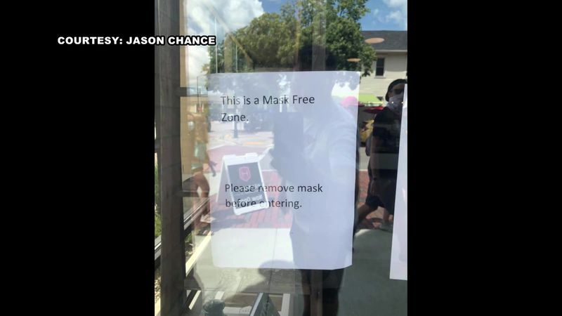 "Helbachs posted this sign outside their Middleton coffee shop: ""This is a Mask Free Zone...."