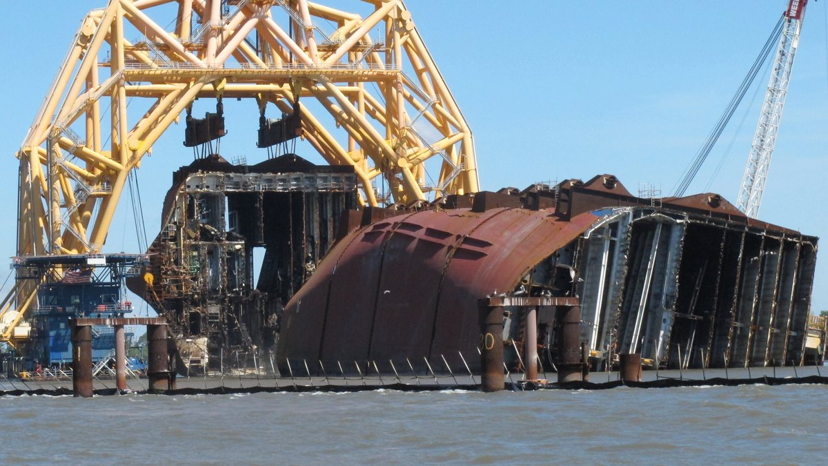 FILE - In this April 26, 2021 file photo, a towering crane pulls the engine room section away...