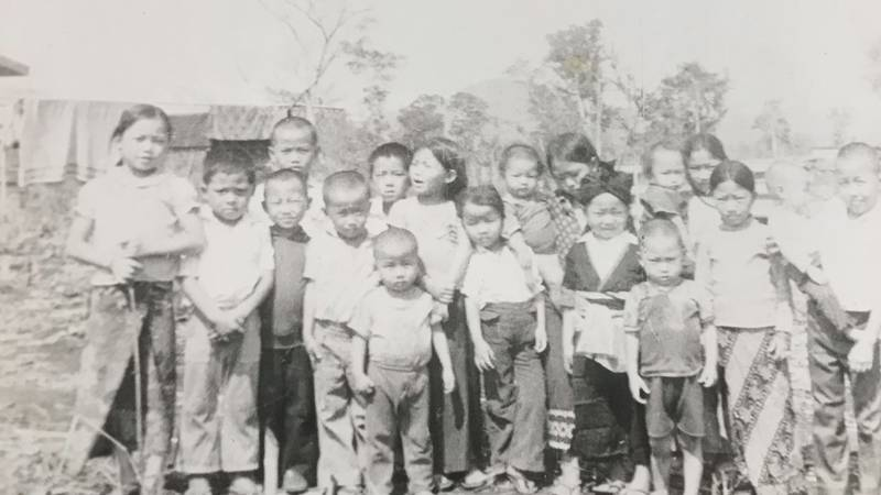 A group of children gathered at Ban Vinai refugee camp in Thailand in the 1970s.