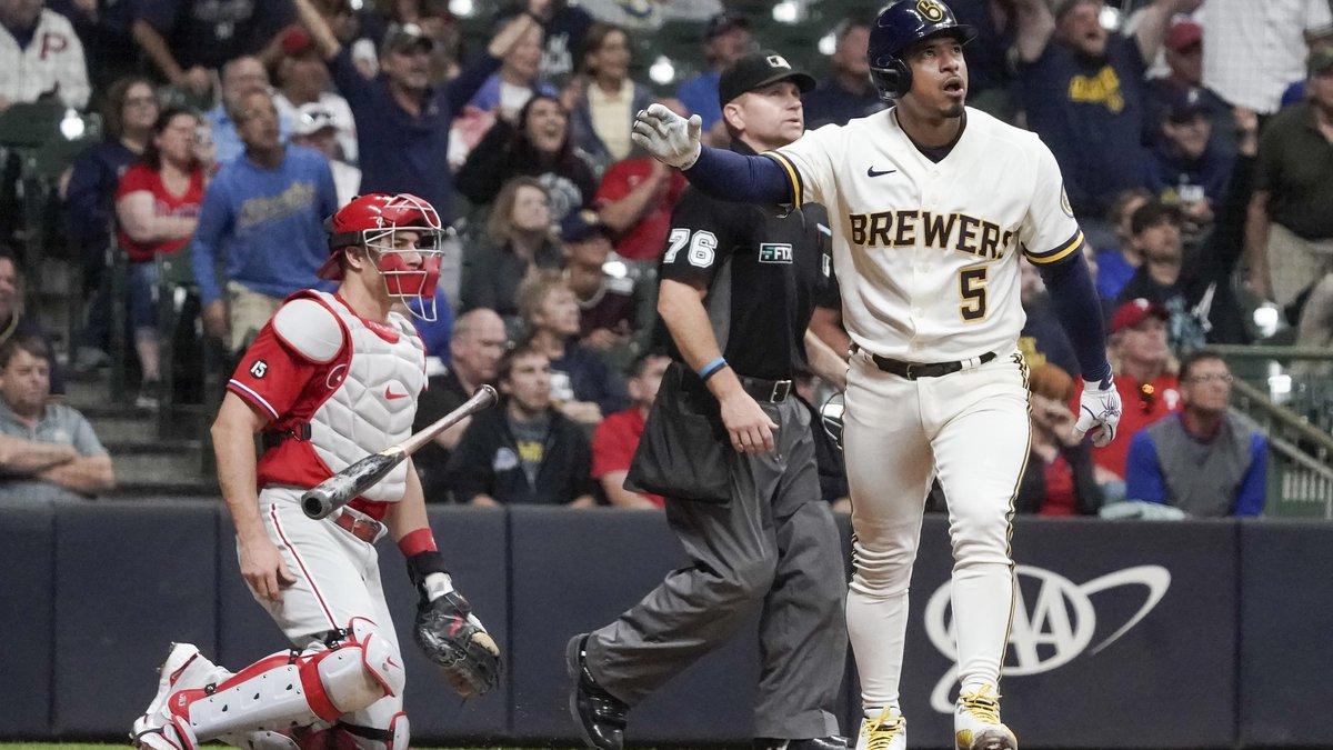Milwaukee Brewers' Eduardo Escobar hits a home run during the sixth inning of a baseball game...