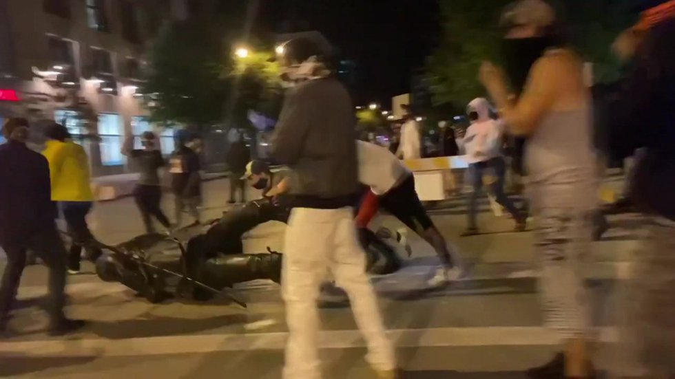 Downtown protesters drag the statue of Hans Christian Heg after tearing it down Tuesday night.