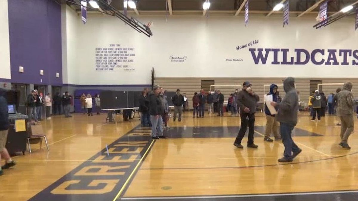 People wait to vote at Green Bay West High School. April 7, 2020. (WBAY Photo)