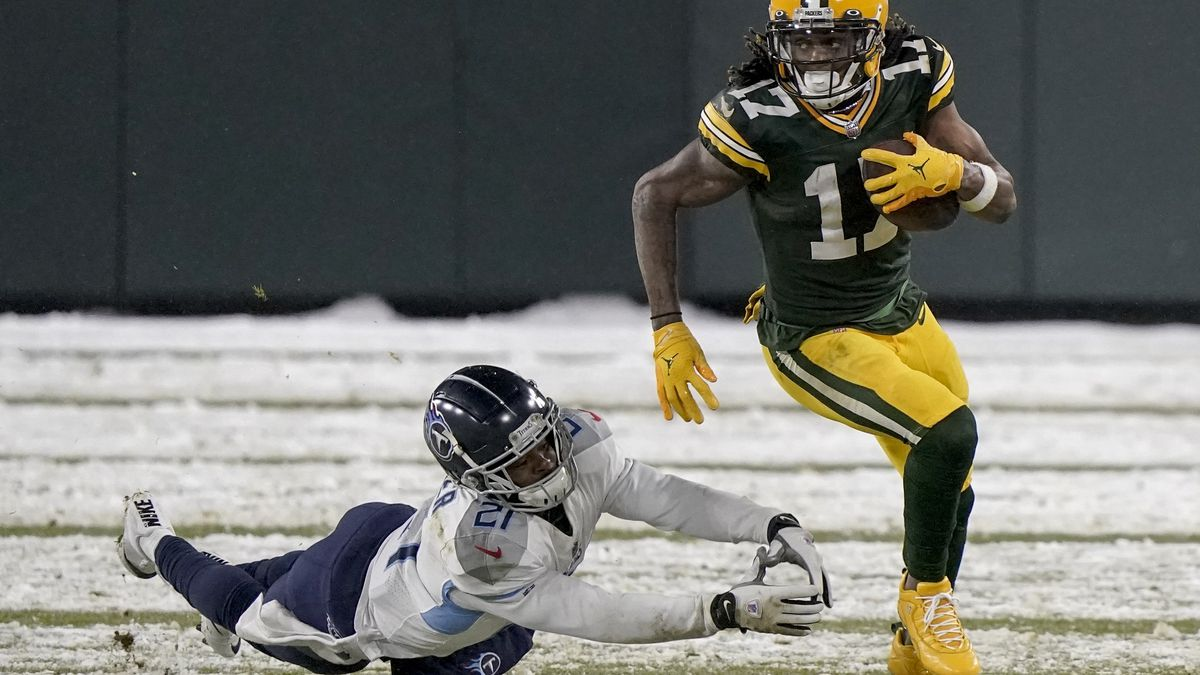 Green Bay Packers' Davante Adams runs past Tennessee Titans' Malcolm Butler during the second...