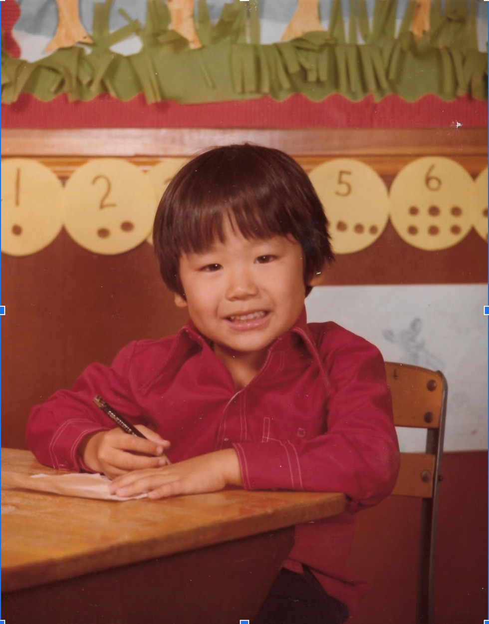 Hong found school difficult at first because he didn't speak English and couldn't communicate...