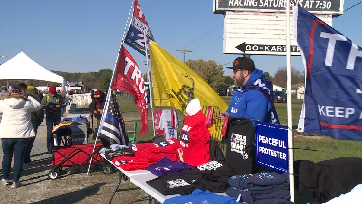Justin Montello selling Trump merchandise ahead of the rally in West Salem Tuesday.